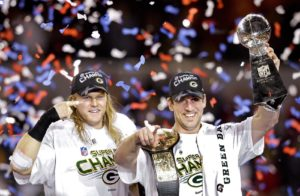 Aaron Rodgers and Clay Matthews celebrating with the Lombardi Trophy after winning the Superbowl against the Pittsburgh Steelers