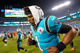 Cam Newton of the Carolina Panthers running with a towel on top of his head