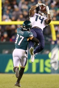 DK Metcalf catches ball over an Eagles defender during the NFL Wild Card round
