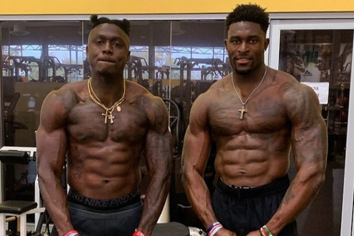 DK Metcalf showing off his abs after a workout