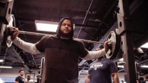 Aaron Donald of the Los Angeles Rams squatting during his workout