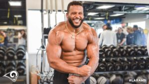 Aaron Donald flexing and showing off his abs after a workout