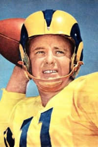 Norm Van Brocklin of the Los Angeles Rams throwing for the most passing yards ever in a game