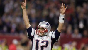 Tom Brady celebrating as the quarterback of the New England Patriots