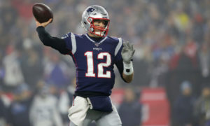 Tom Brady throwing the football while playing for the New England Patriots