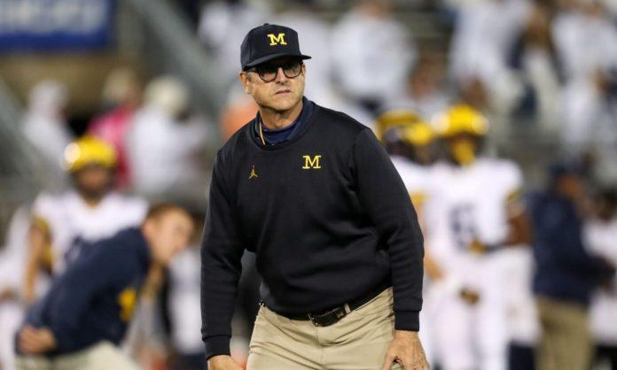 Michigan football coach Jim Harbaugh surprised students at an Ohio School