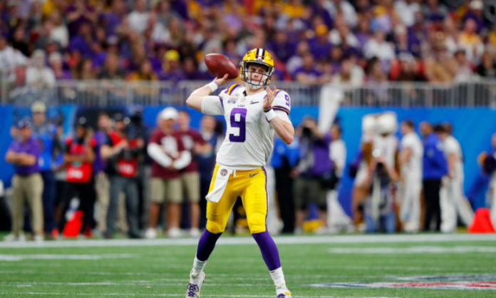Joe Burrow throwing the football while playing for LSU
