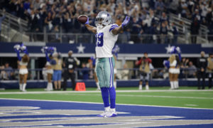 Dallas Cowboys wide receiver Amari Cooper celebrating in the endzone after scoring a touchdown