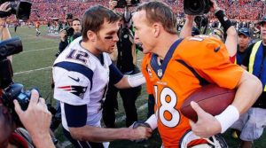 Peyton Manning of the Denver Broncos and Tom Brady of the New England Patriots meet after the AFC Championship game in Denver
