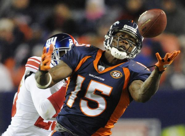 Brandon Marshall makes a catch while playing for the Denver Broncos