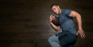 Christian McCaffery posing with a football