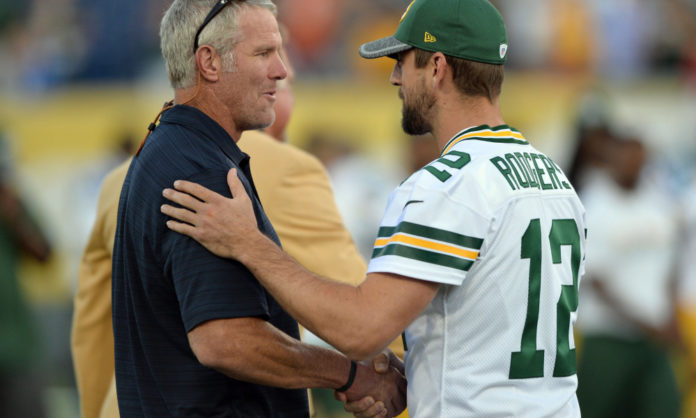 Aaron Rodgers shaking hands with Brett Favre