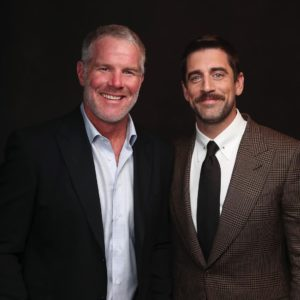 Brett Favre and Aaron Rodgers dressed in suits
