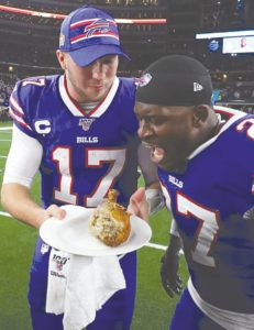 Josh Allen and Tre'Davious White of the Buffalo Bills celebrate their Thanksgiving day win by eating a turkey leg post game in Dallas.
