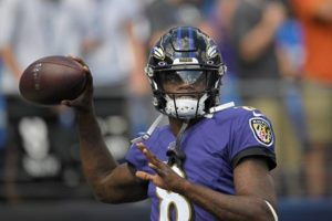 Lamar Jackson of the Baltimore Ravens throwing the football