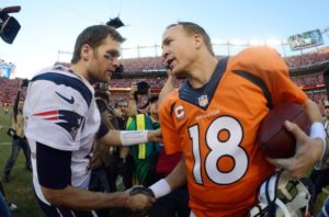 Peyton Manning and Tom Brady shake hands amidst the Brady vs Manning rivalry