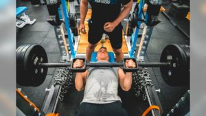 Chistian McCaffery benching as part of his workout