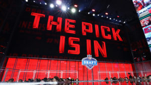 The NFL draft screen that displays that the pick is in