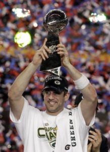 Aaron Rodgers hoists the Lombardi trophy after winning the Superbowl in 2010 with the Green Bay Packers