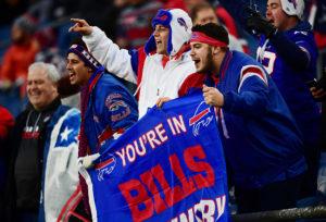 Buffalo Bills fans celebrating in the stands as a part of Bills Mafia