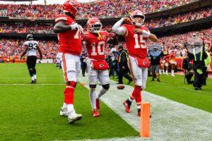 Kansas City Chiefs offense celebrating after scoring a touchdown