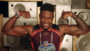 Seahawks wide receiver DK Metcalf flexing his biceps at the 2019 NFL Combine