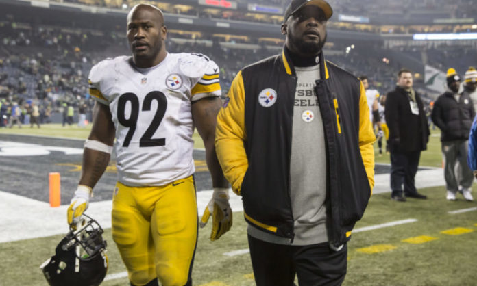 James Harrison walks with Mike Tomlin while part of the Pittsburgh Steelers