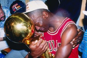 Michael Jordan cries with his first NBA championship trophy in 1991