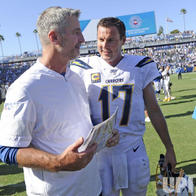 Head coach of the Indianapolis Colts talks with quarterback Philip Rivers