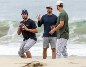 Josh allen throwing on a beach